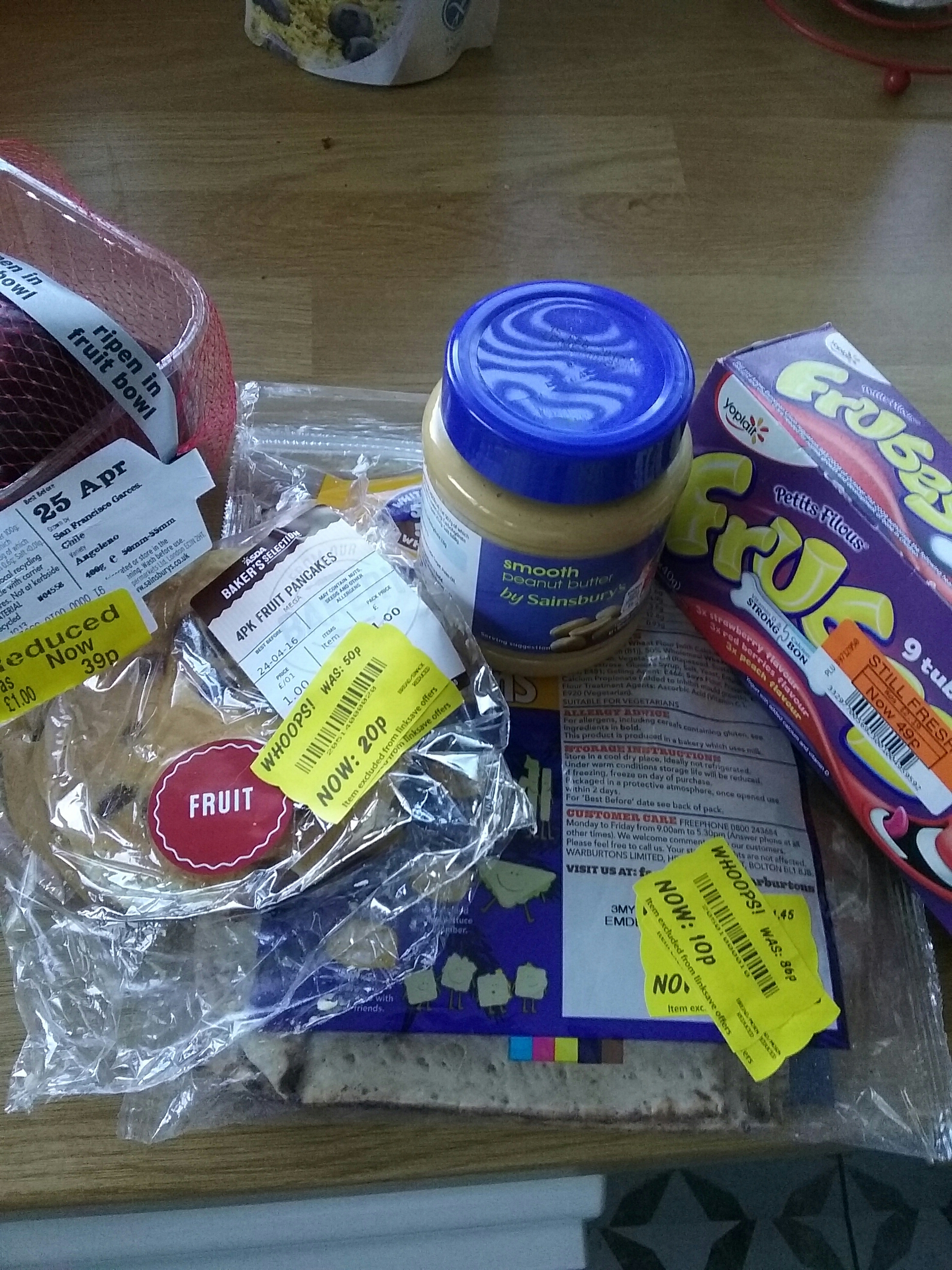 picture of peanut butter, frubes with orange reduced tag, pancakes and fruit with yellow reduced tags
