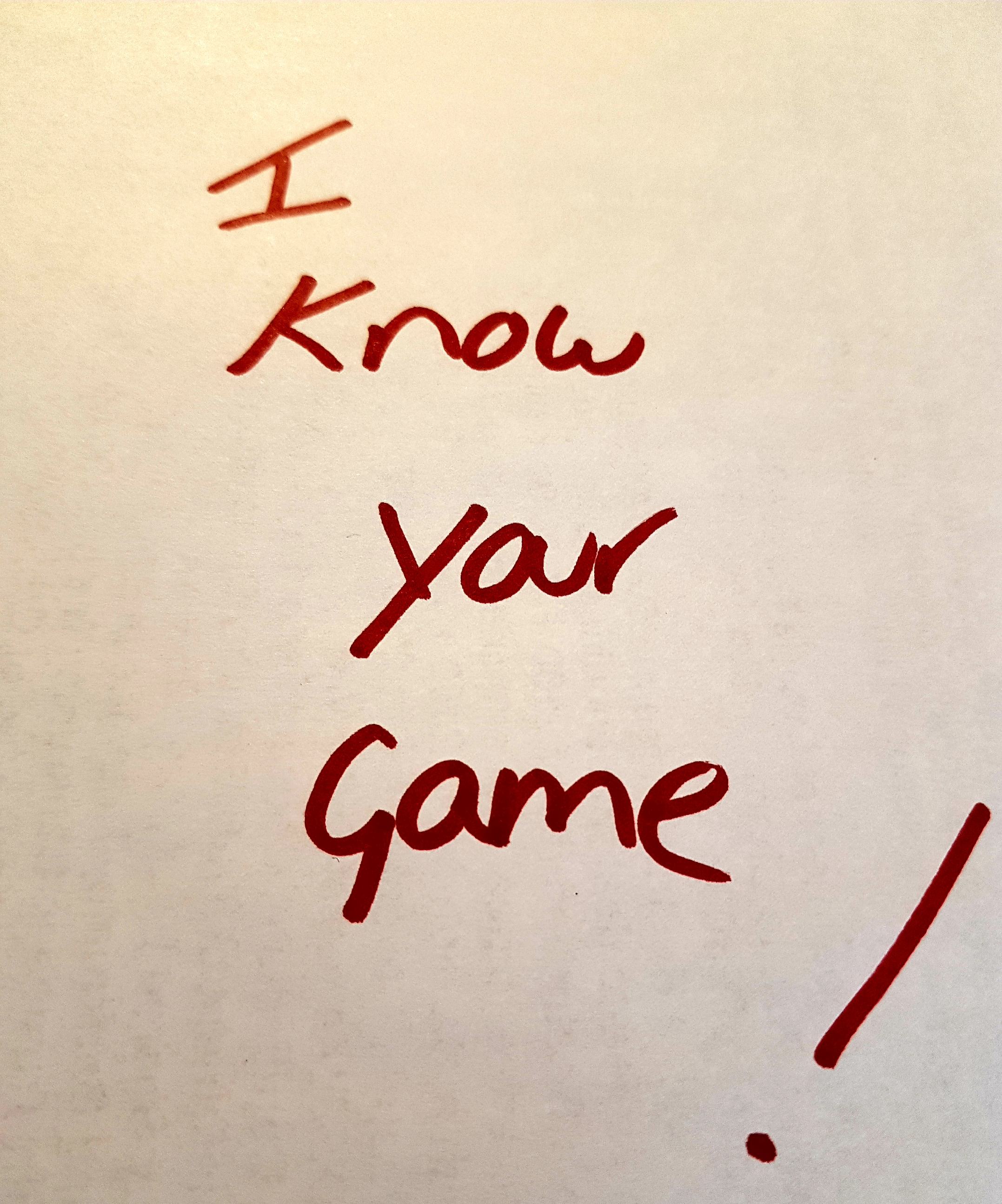 'I know your game!' written on paper in red pen